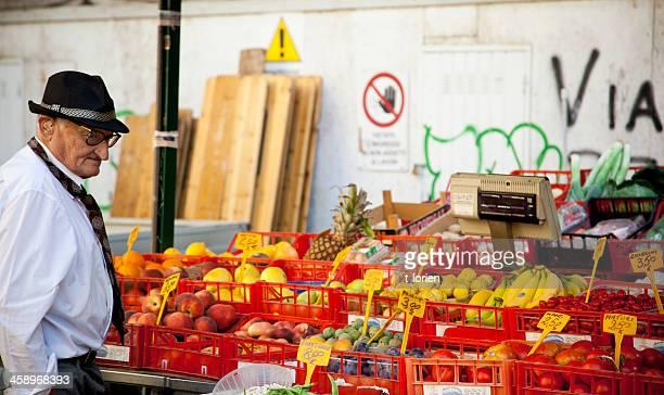 old man shopping in pisa. italy - pisa stockfoto's en -beelden