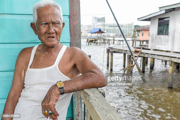 Old man sitting by the veranda of his house in Kampung Ayer... News Photo - Getty Images