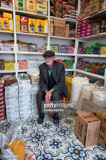 old man sitting in a retail shop,bergama. - emreturanphoto stock pictures, royalty-free photos & images