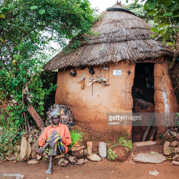 """old man sitting infront of his house - tata somba, benin - """"peeter viisimaa"""" or peeterv stock pictures, royalty-free photos & images"""