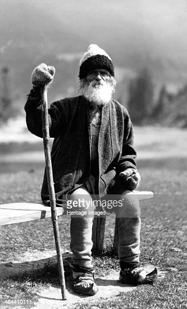 Old man sitting on a bench Bistrita Valley Moldavia northeast Romania c1920c1945 Depicting customs and traditional labour in the rural Carpathian...