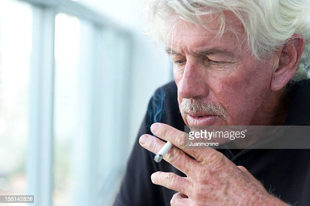 old man smoking - smoking issues stock pictures, royalty-free photos & images
