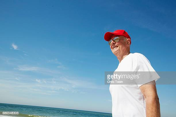 Old man standing at the beach