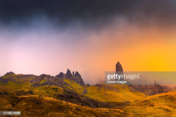 old man storr in isle of skye with magic orange light abstract feel - 2016 stock pictures, royalty-free photos & images