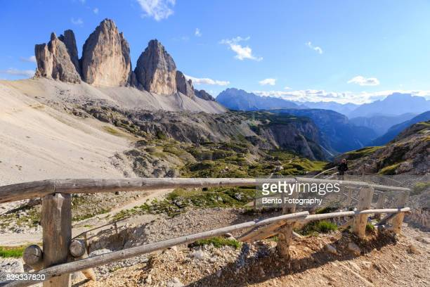 Old man take a look at the wonderful landscape of Tre cime, Dolomite, Italy