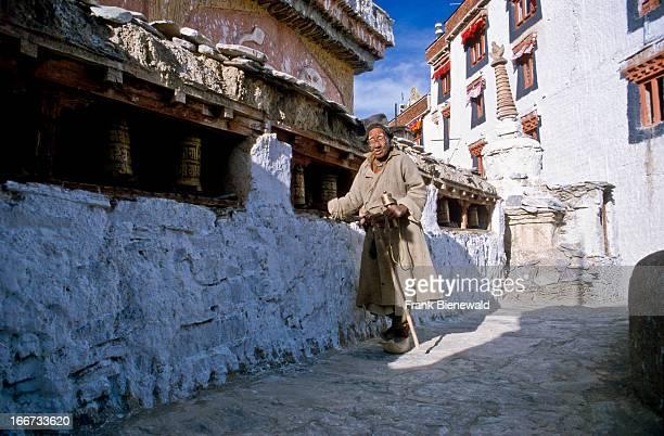 Old man turning prayerwheels in Lamayuru Gompa