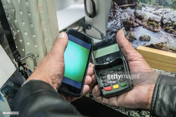 Old Man Using Mobile/Contactless Payment