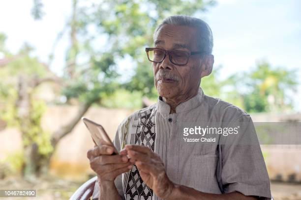 Old Man Using Smart Phone