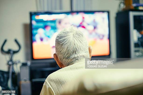 Old man watching TV
