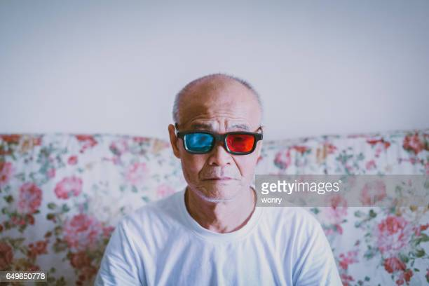 Old man watching with 3D glasses