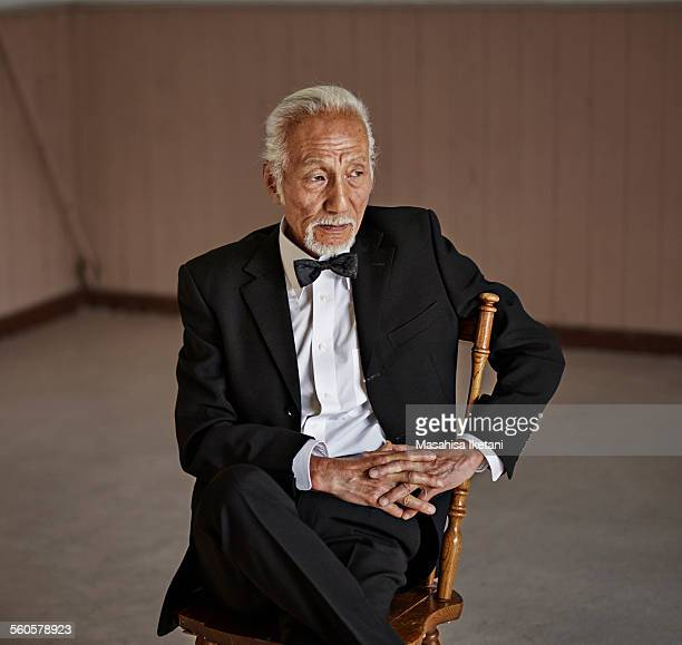Old man wearing a black suit