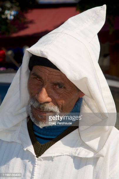 old man wearing a djellaba. - partially sighted stock pictures, royalty-free photos & images