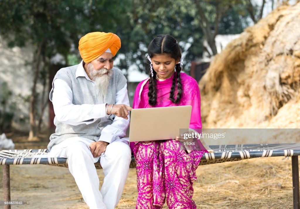 Old man with girl using laptop : Stock Photo