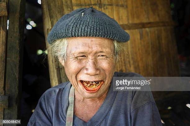 Old man with rotten teeth chewing Betel nut