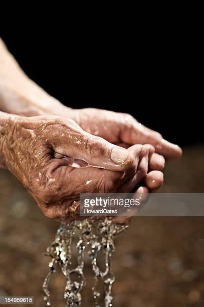 Old man's Hands cupping and drinking water
