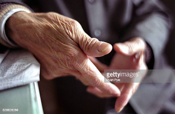 A old mans wrinkled hands at the Huang Pu District Old People's Home which opened its doors in 1983 and is government owned and run The home has 256...