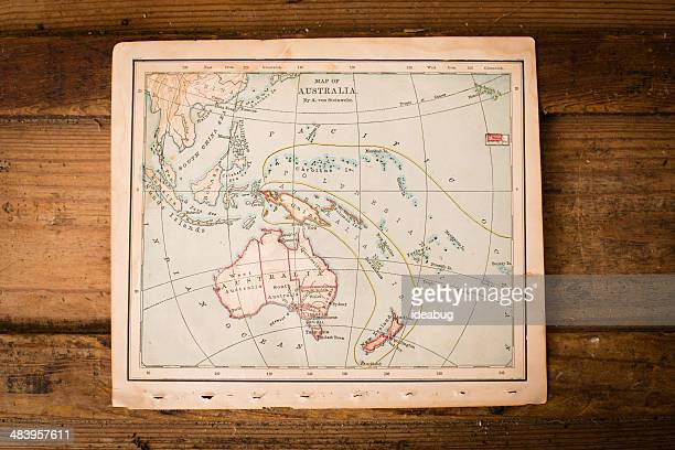 old map of australia, sitting on wood trunk - indonesia map stock photos and pictures