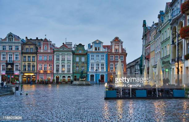 old market at dusk in poznań, poland - poland stock pictures, royalty-free photos & images