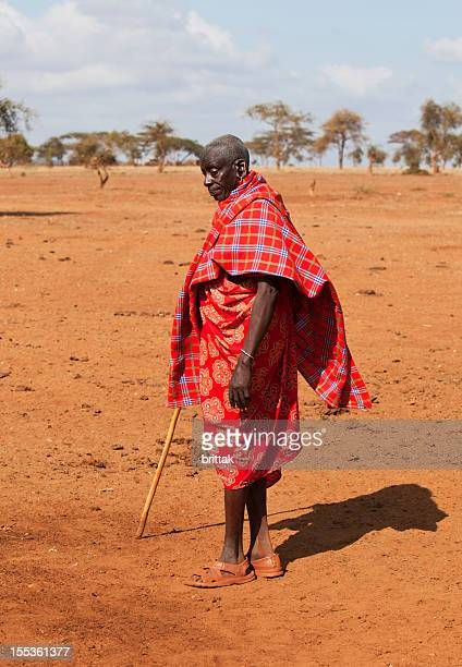 Old masai headman in arid landscape during dry season