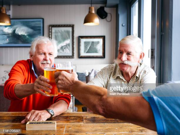 old men at the pub - friendship stock pictures, royalty-free photos & images