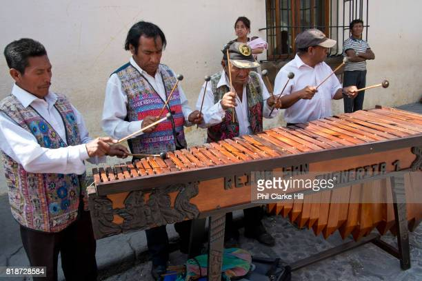 Old men playing a marimba in Antigua old town The city is the old colonial capital of Guatemala located in the central highlands it is a UNESCO World...