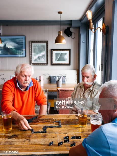 old men playing dominoes - competition stock pictures, royalty-free photos & images