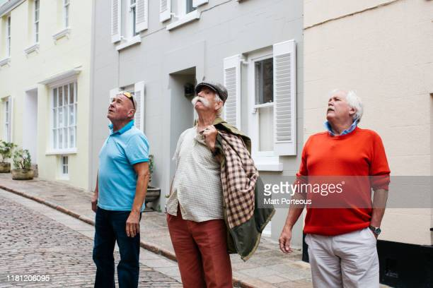 old men walk down cobbled streets - archival stock pictures, royalty-free photos & images