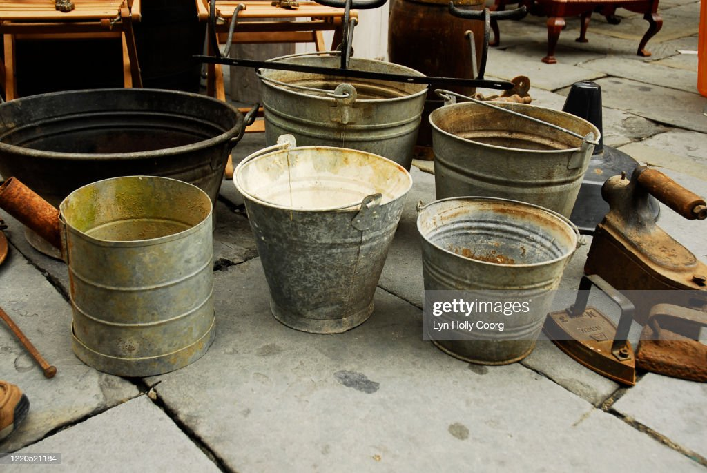 Old metal buckets for sale in market : Stock Photo