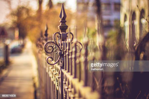 old metal fence in urban area, germany - gehweg stock pictures, royalty-free photos & images