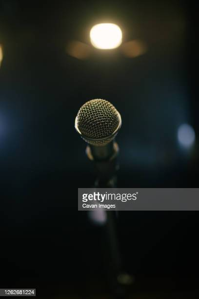 old microphone on stage closeup. - grimes musician stock pictures, royalty-free photos & images