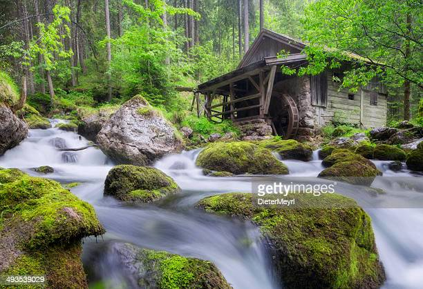 Old Mill in European Alps at springtime