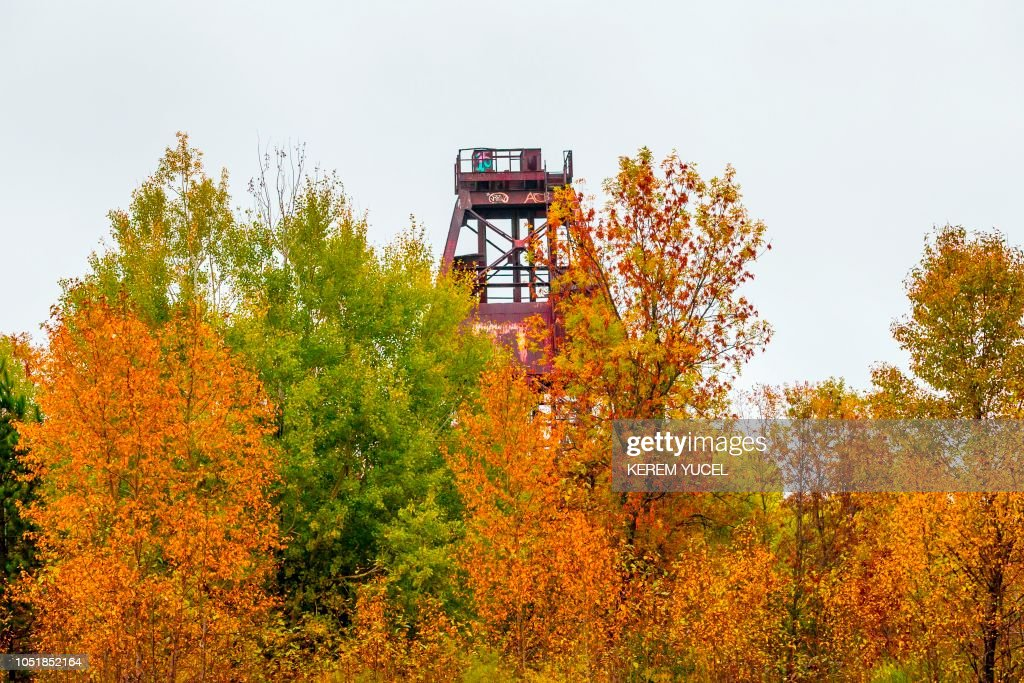 Old mining steel headframe sits above an abandoned mine