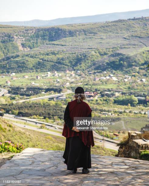 Old monk standing at the Monastery of Jvari