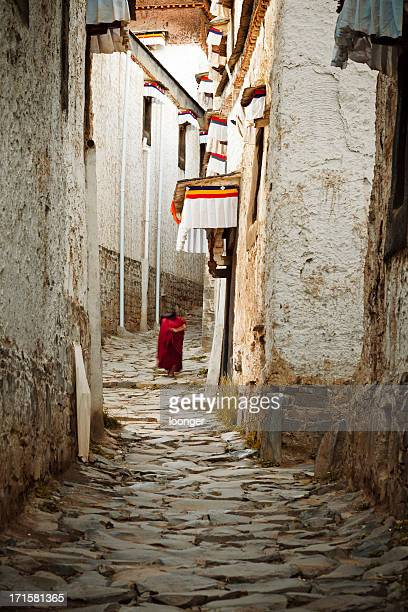 Old monk walking in the narrow street