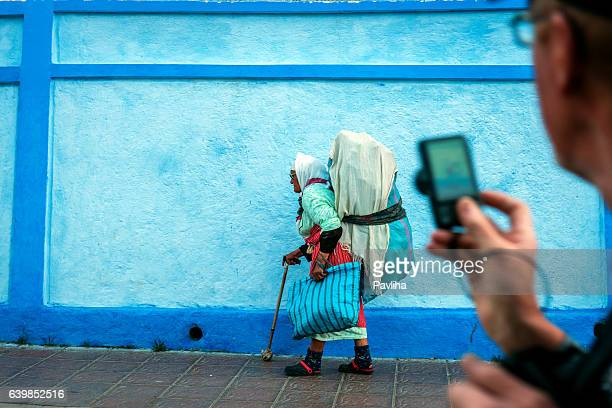 Old Moroccan Woman Carrying Waste on the Back, Chefchaouen, Morocco