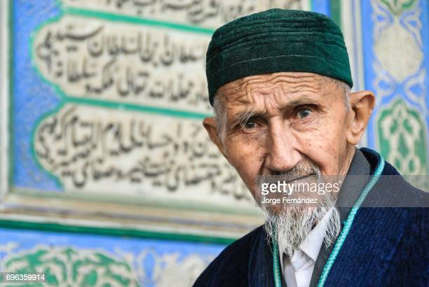 BUKHARA KHORASAN UZBEKISTAN Old muslim man looking straight to the camera