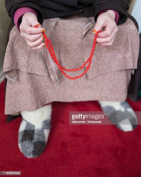 old muslim woman is praying - namaz stock pictures, royalty-free photos & images