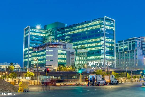 old mutual building in sandton in the evening, johannesburg - sandton stock pictures, royalty-free photos & images