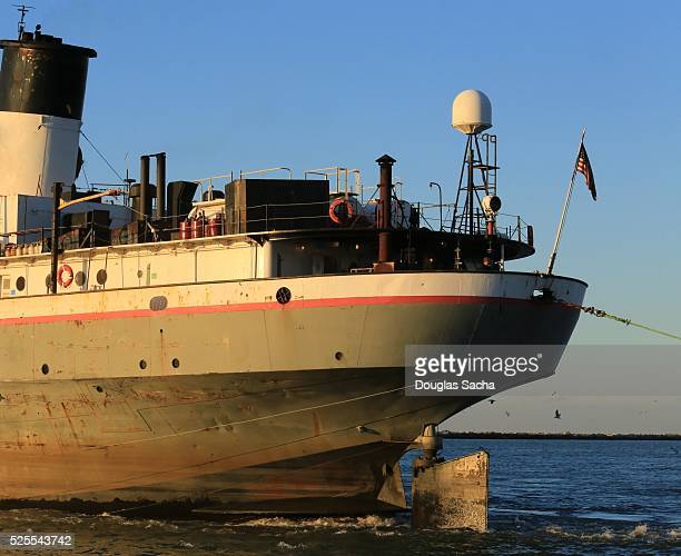 Old nautical Freight ship leaves the harbor