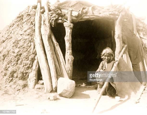 Old Navajo Indian seated in doorway of hogan 1901