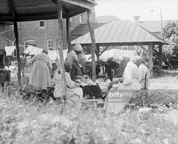 Old Negro folk who were slaves in the South before the Civil War being cared for by the government at Blue Plaines Home near Washington There the old...