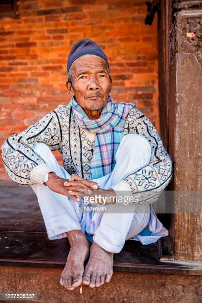 old nepali man resting in kathmandu - nepalese ethnicity stock pictures, royalty-free photos & images
