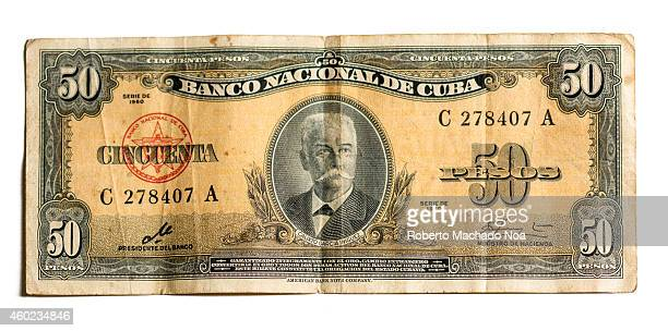 Old non circulating Cuban fifty 50 bill or money signed by Ernesto Che Guevara when he was president of the bank the note has the face of Cuban hero...