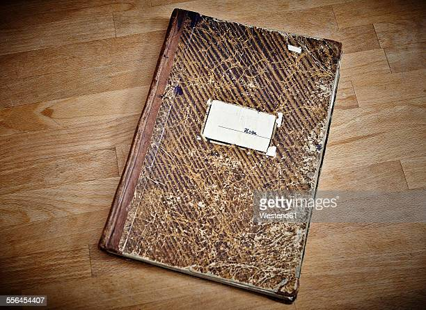 Old notebook on wooden table