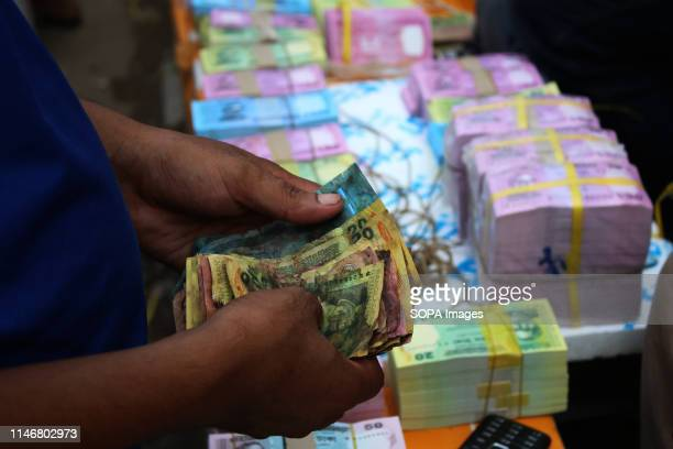 Old notes seen next to new banknotes at Gulistan in the capital ahead of EidUlFitr Real Banknotes are on sale before each Eid due to the tradition...