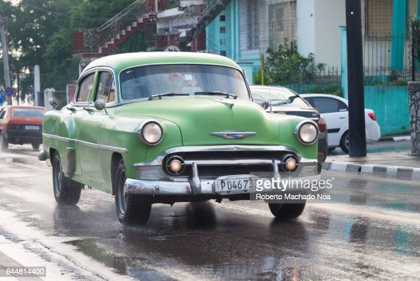 Old obsolete Chevrolet 1950 American car in urban areas Cuban transportation and lifestyle in rainy day