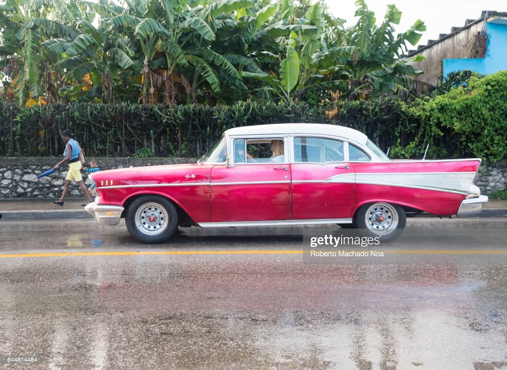 Old obsolete pink Chevrolet 1957 American car in urban... Pictures
