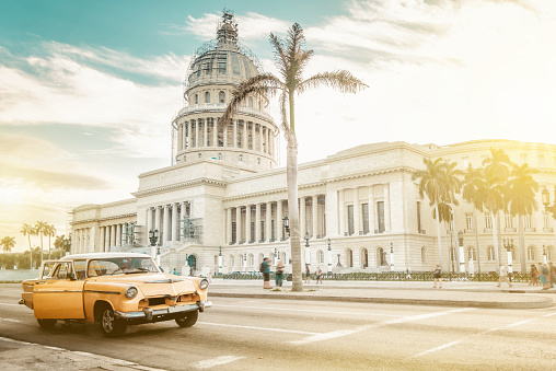 old orange american car in front of Capitol in Havanna - gettyimageskorea