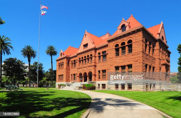 Old Orange County Courthouse and palm trees in the sun