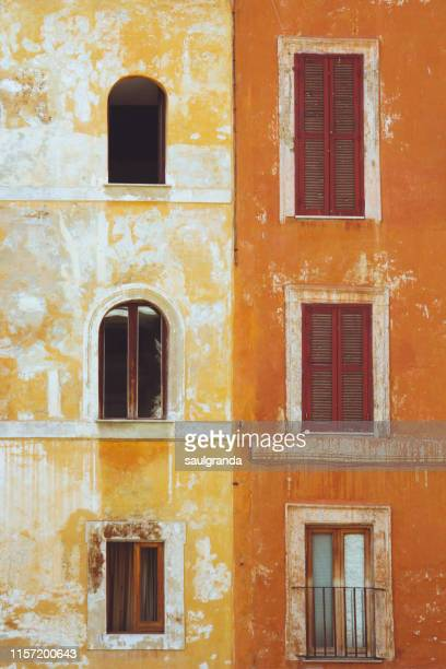 old orange facades - mediterranean culture stock pictures, royalty-free photos & images